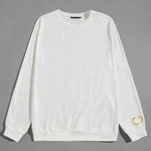 Pullover mit goldener Grafik Muster