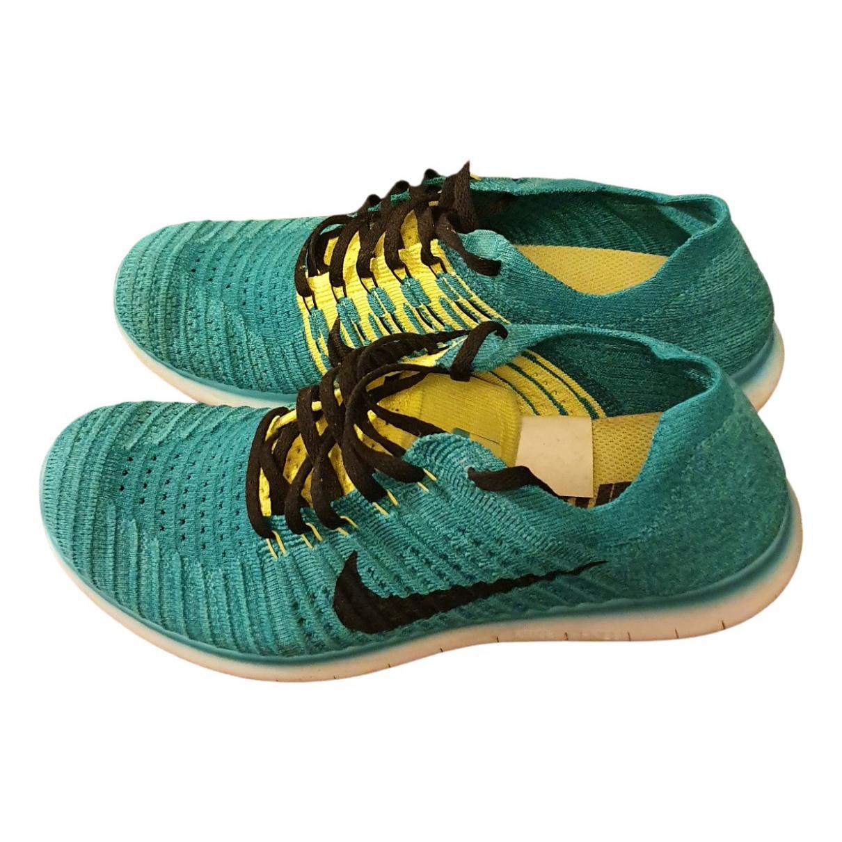 Nike - Baskets Free Run pour homme en toile - vert