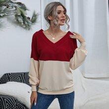 Zweifarbiger Pullover mit V Kragen