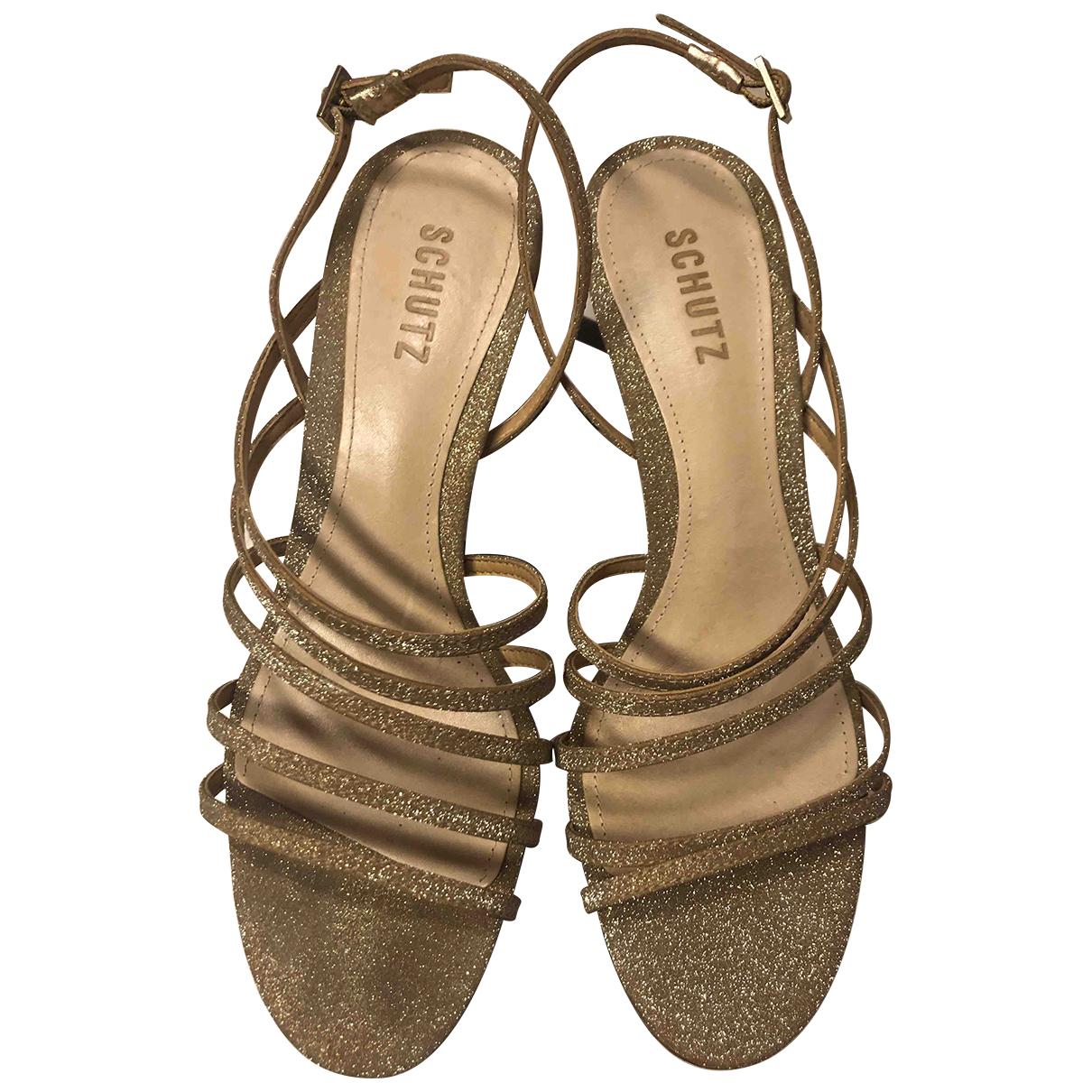Schutz \N Sandalen in  Gold Leder