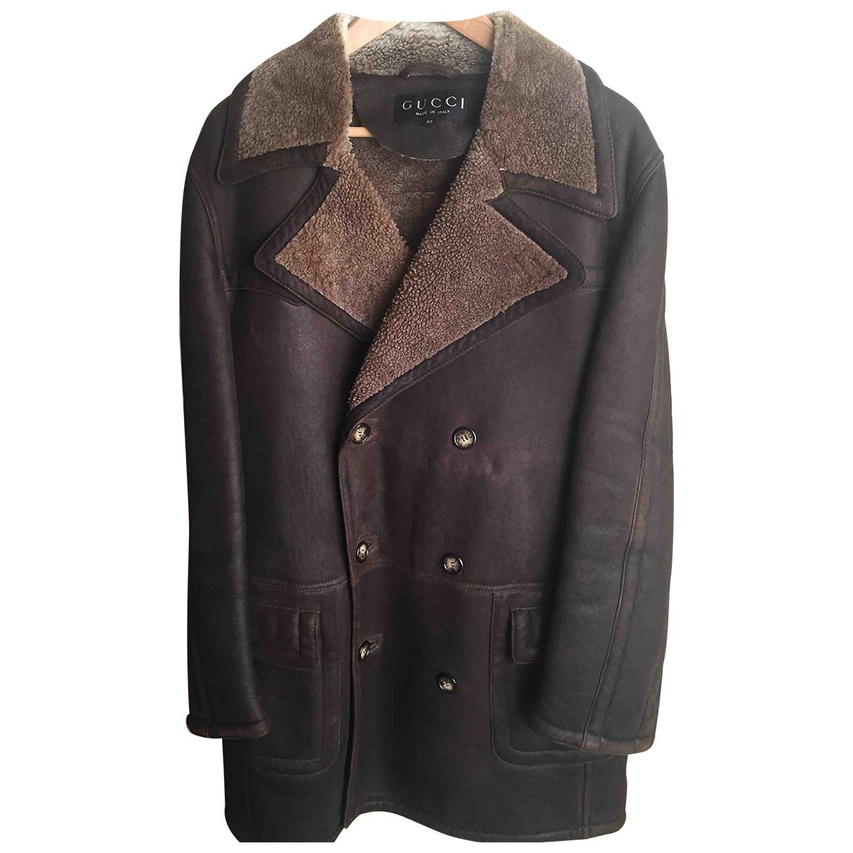 Gucci - Manteau   pour homme en mouton - marron