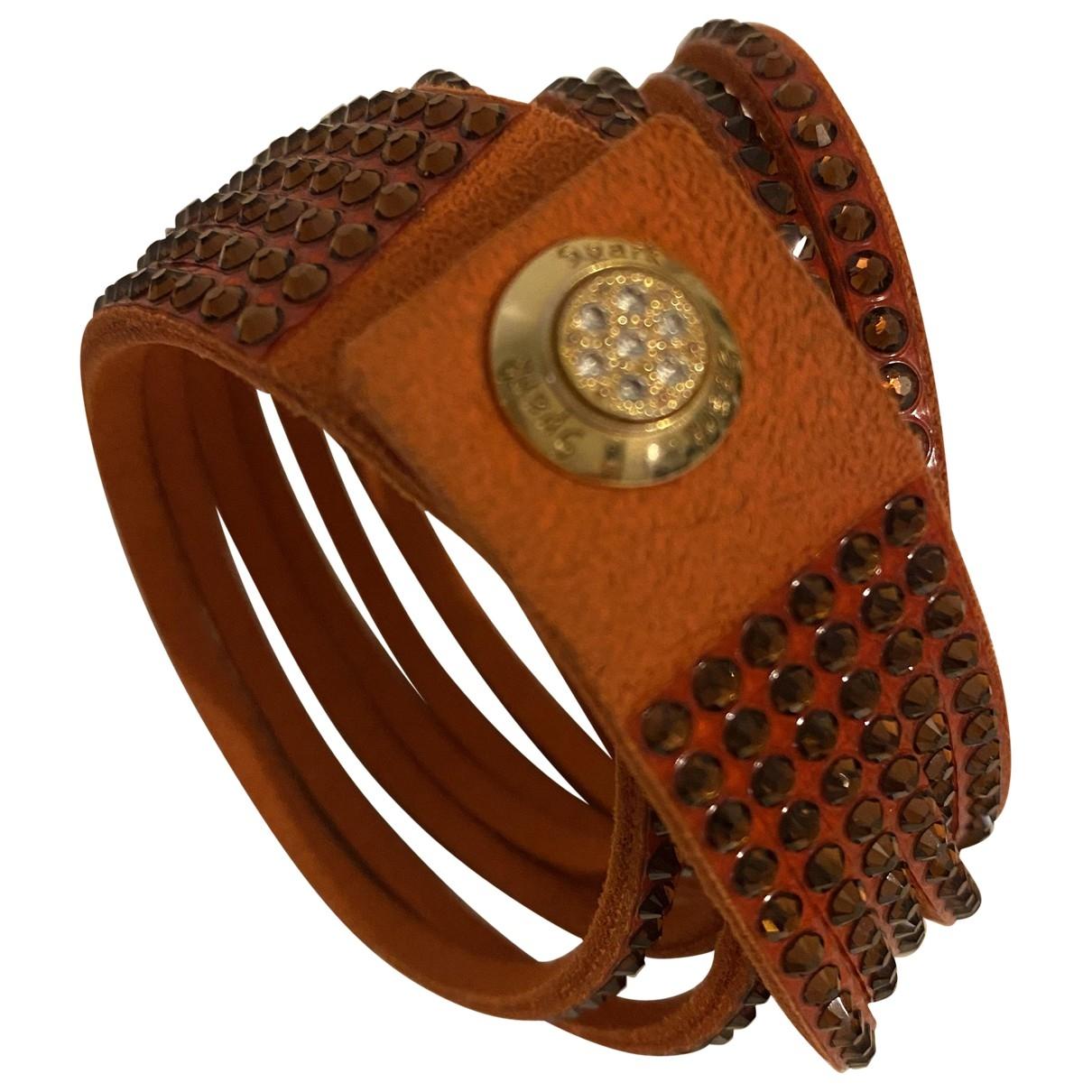 - Bracelet   pour femme en cuir - orange