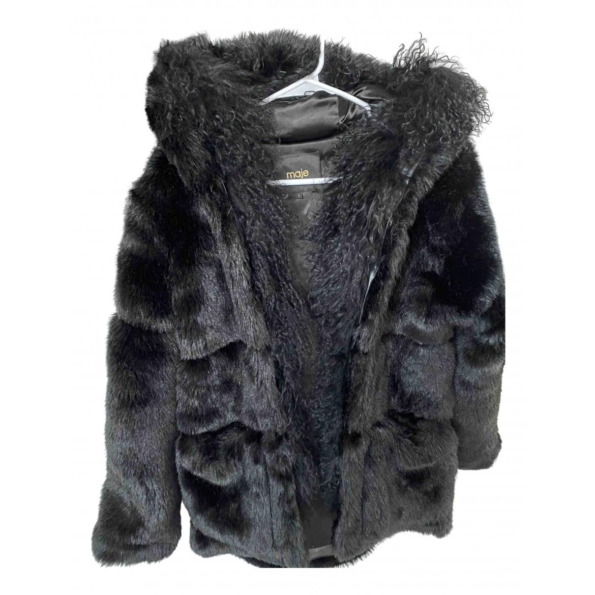 Maje - Manteau   pour femme en agneau de mongolie - noir