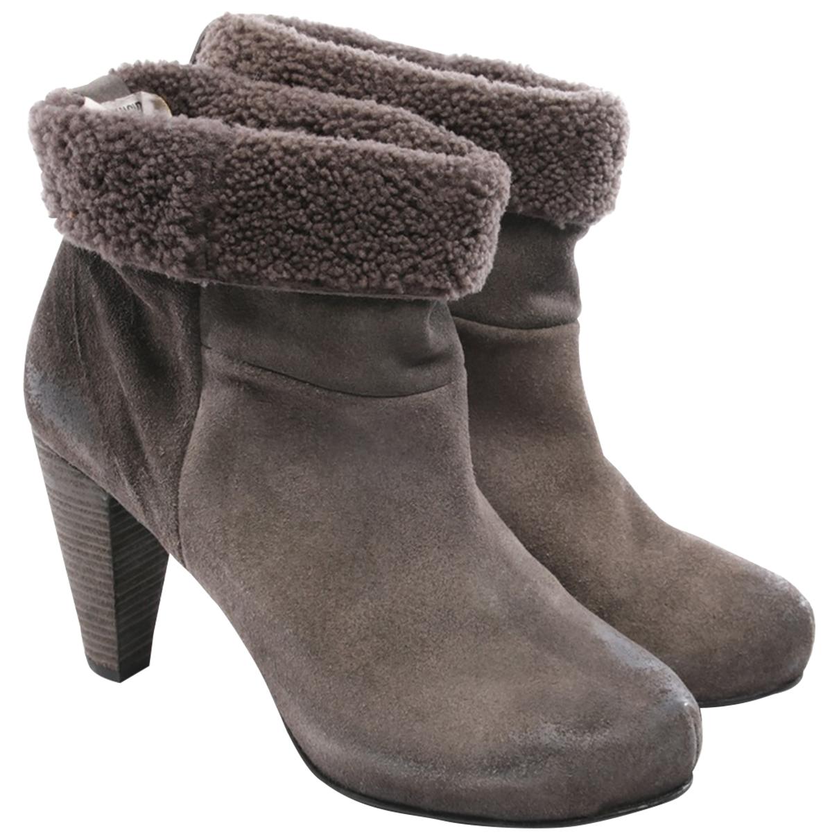 Humanoid - Boots   pour femme en fourrure - gris