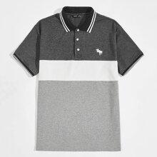 Polo Shirt mit Streifen am Saum, Stickereien und Farbblock