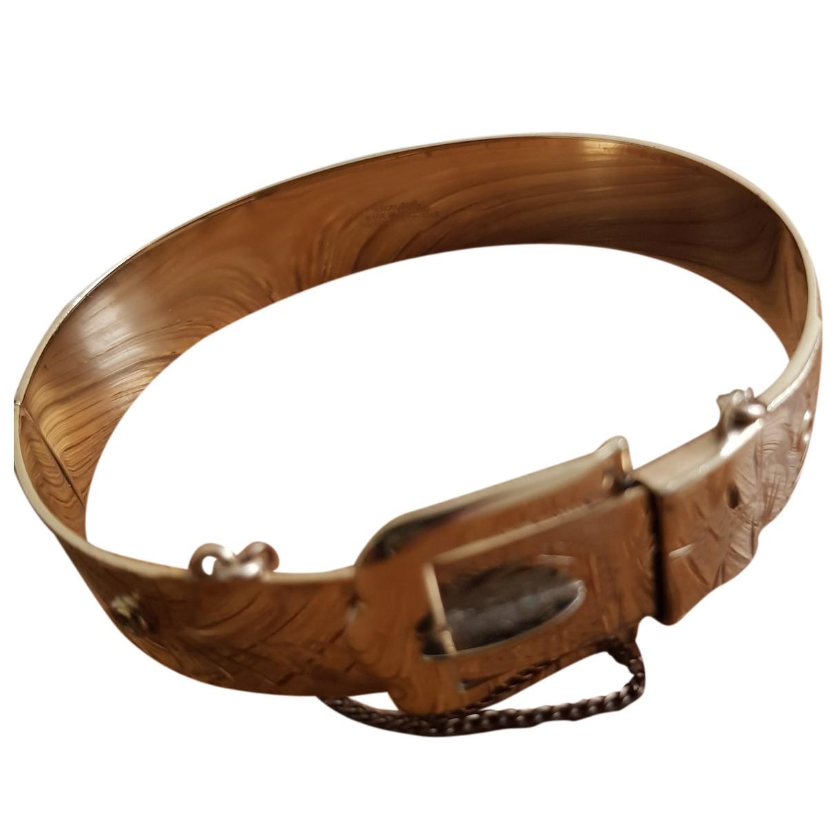 - Bracelet   pour femme en cuir - dore