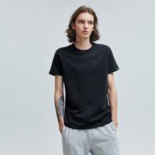 T-Shirt mit Flicken und kurzen Ärmeln