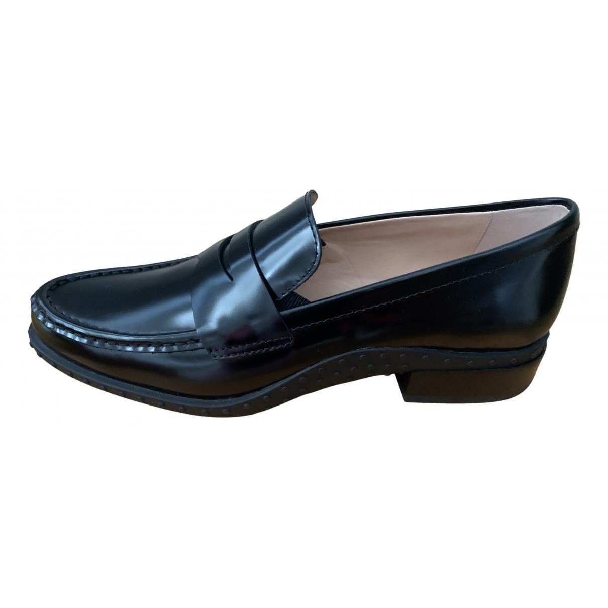 Tod's - Mocassins   pour femme en cuir - noir