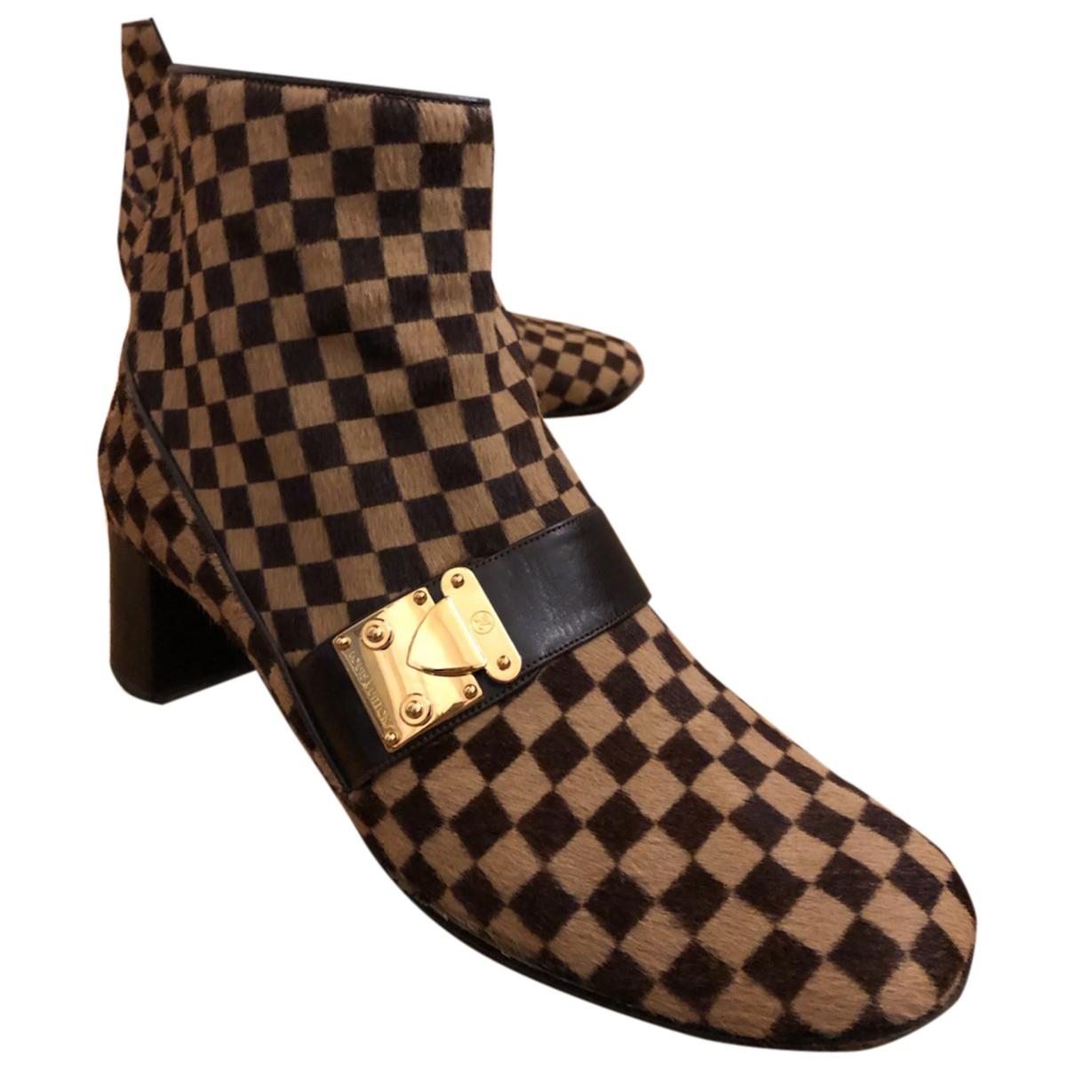 Louis Vuitton - Boots   pour femme en veau facon poulain - camel