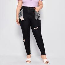 Schmale Jeans mit Fransen und Riss