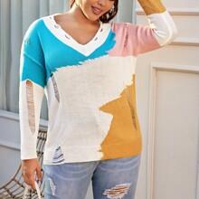 Pullover mit sehr tief angesetzter Schulterpartie, Riss und Farbblock