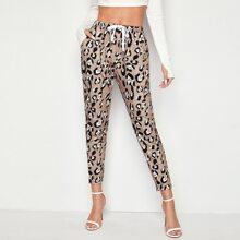Hose mit komplettem Muster, schraegen Taschen und Kordelzug