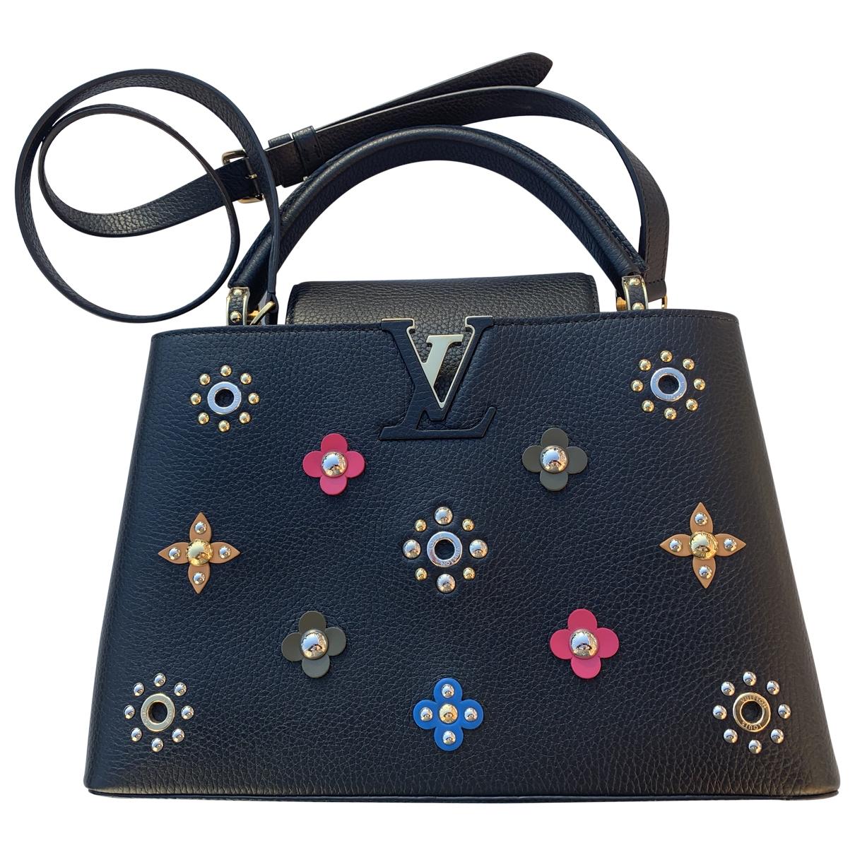 Louis Vuitton Capucines Black Leather handbag for Women \N