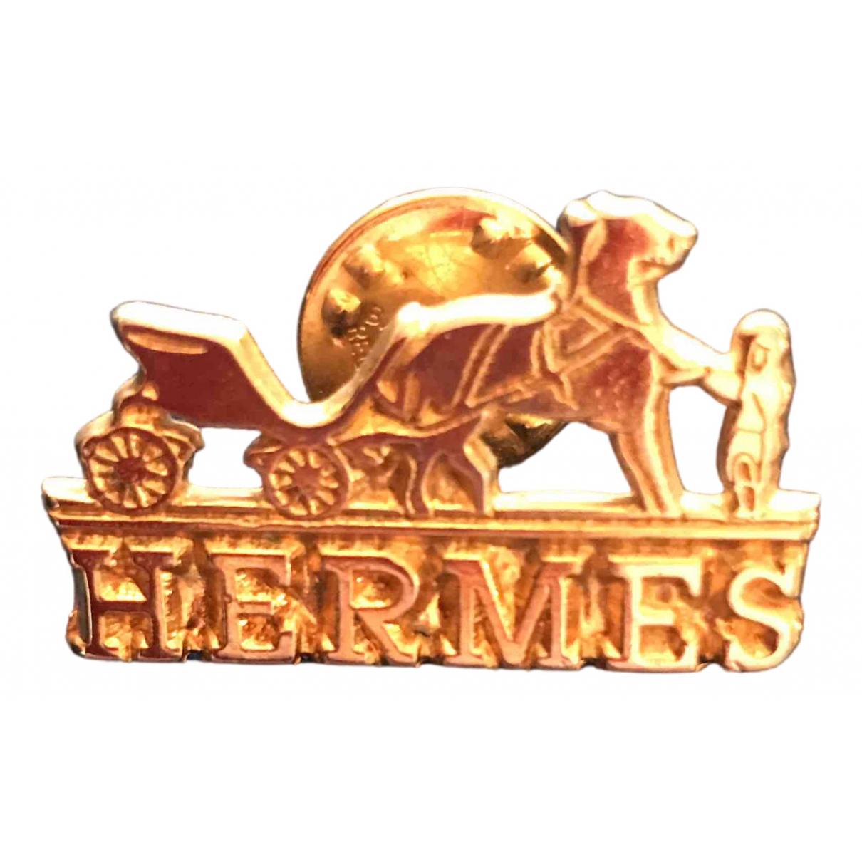 Broche en Metal Dorado Hermes