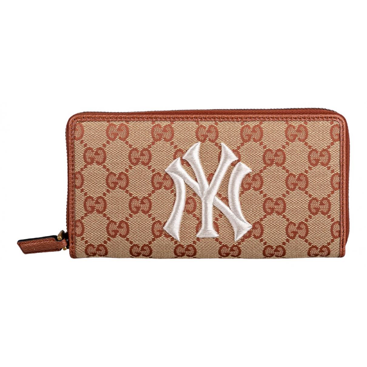 Gucci - Portefeuille   pour femme en toile - beige