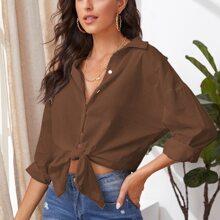 Bluse mit sehr tief angesetzter Schulterpartie und gebogenem Saum