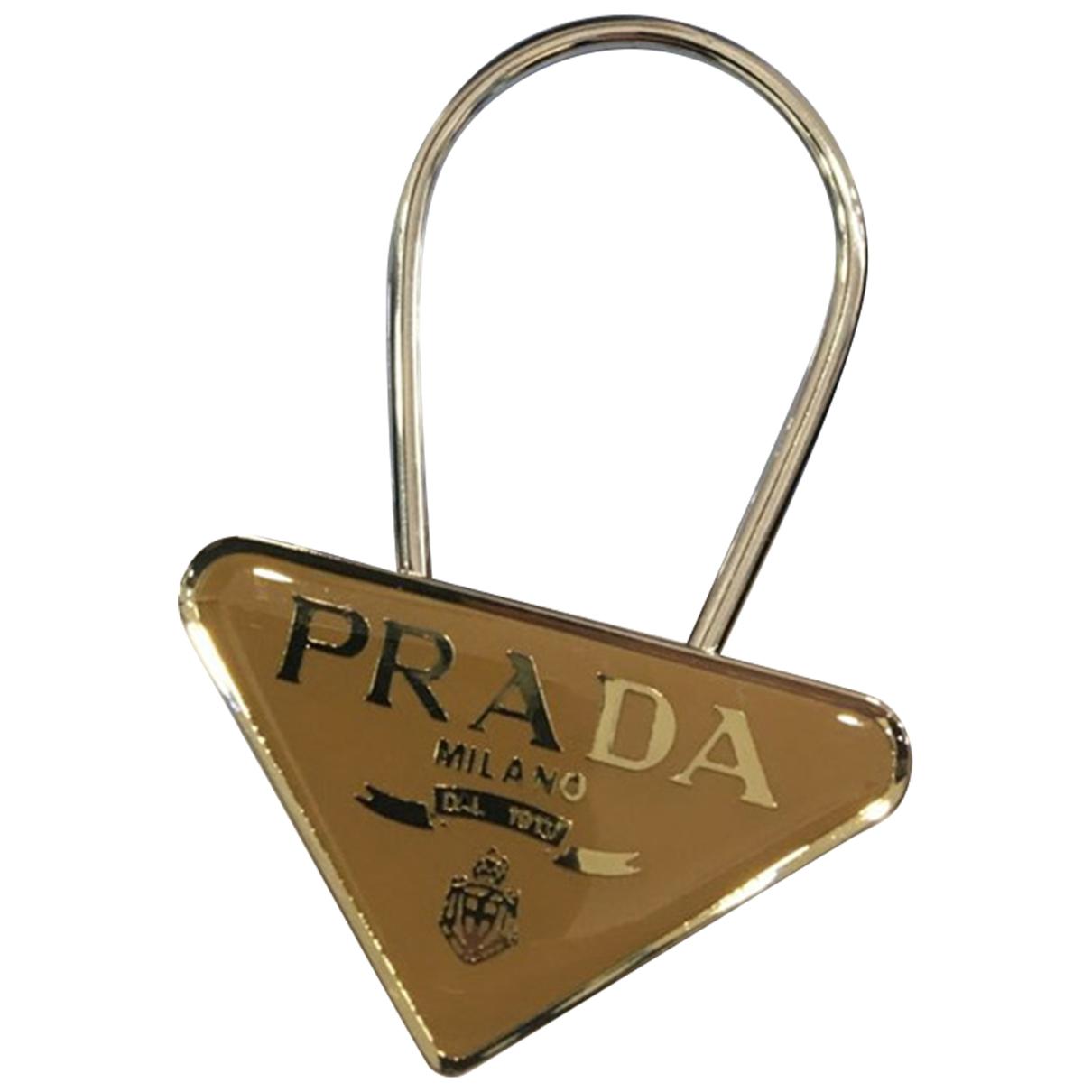 Prada \N Taschenschmuck in  Beige Metall