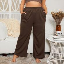 Pantalones de pierna ancha con bolsillo oblicuo