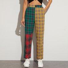 Pantalones con estampado de tartan con diseño de bolsillo oblicuo