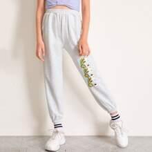 Pantalones deportivos con estampado de figura