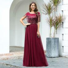 Kleid mit Kontrast Pailletten, Fransen und Netzstoff