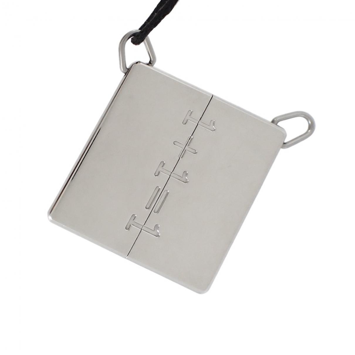 Hermès \N Silver Steel pendant for Women \N