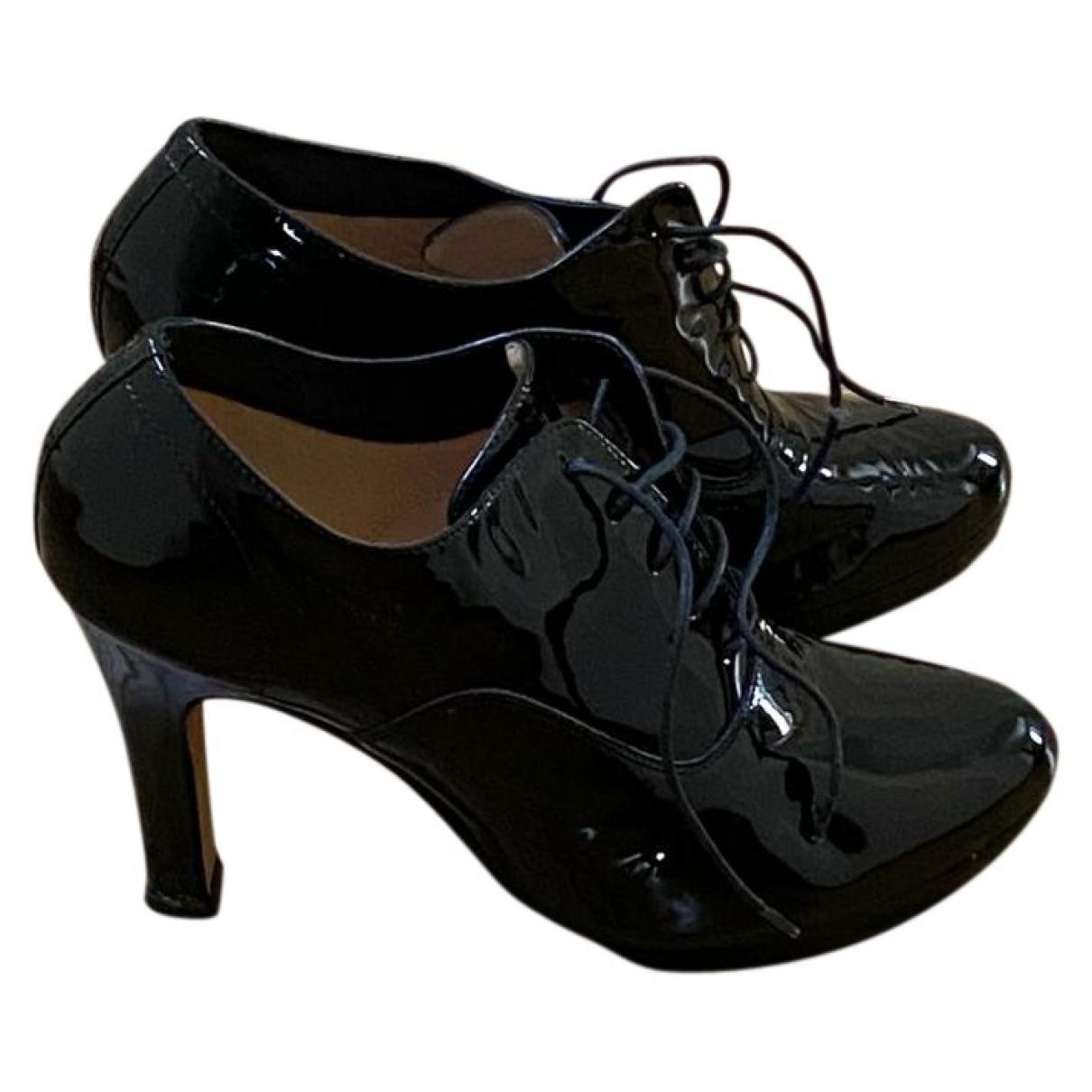 Repetto - Boots   pour femme en cuir verni - noir
