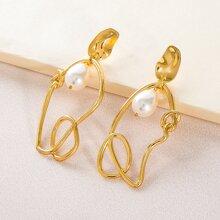 Pendientes largos con nudo con perla artificial