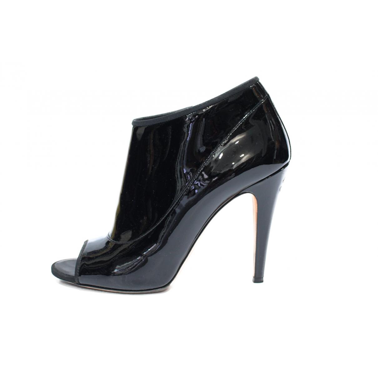 Chanel - Boots   pour femme en cuir verni - noir