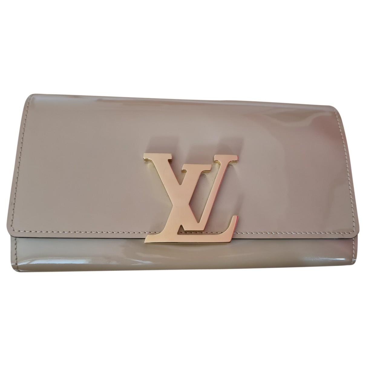 Louis Vuitton - Portefeuille Capucines pour femme en cuir verni - beige