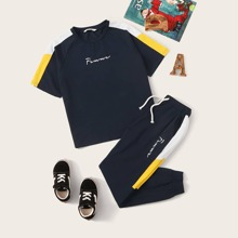 Conjunto de niños top con letra de manga raglan con joggers