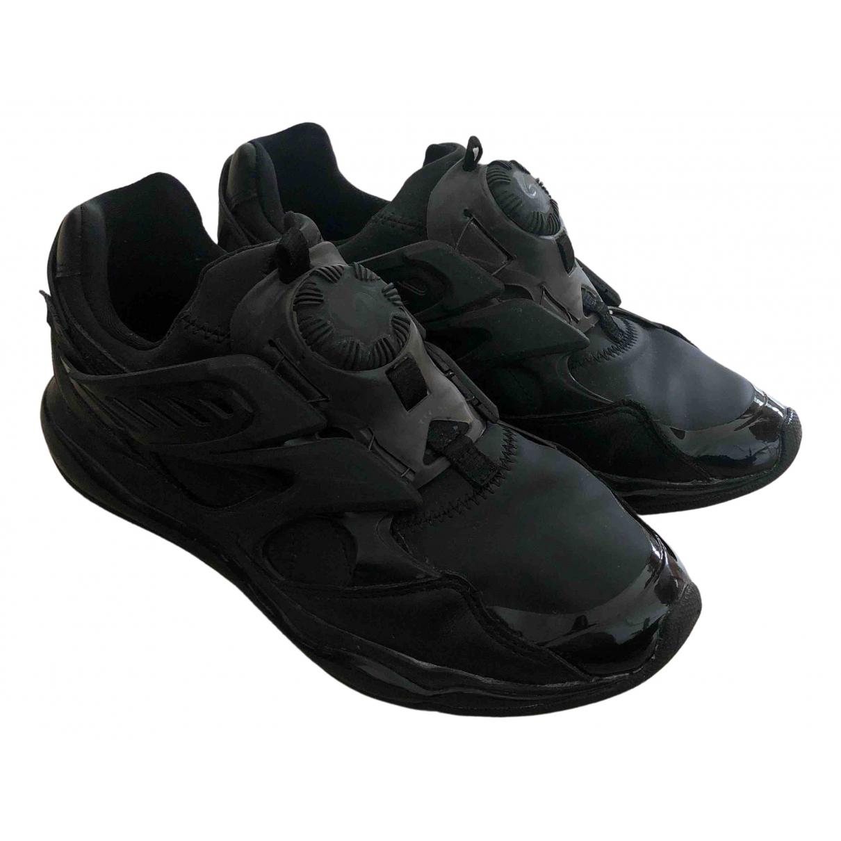 Puma \N Sneakers in  Schwarz Kunststoff