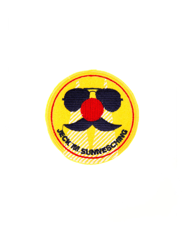 Kostuemzubehor Aufnaeher Jeck im Sunnesching 7cm Farbe: gelb/weiss