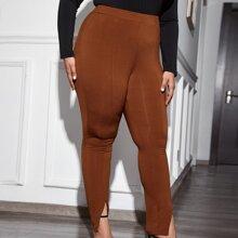 Pantalones bajo con abertura de cintura alta