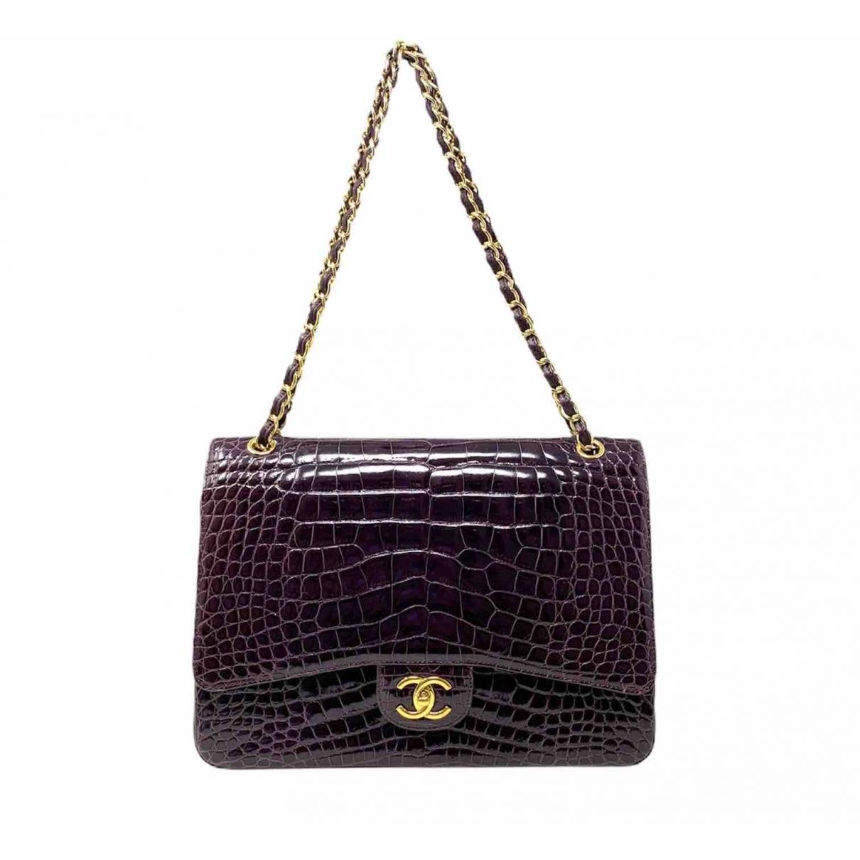 Chanel Timeless/Classique Handtasche in  Lila Krokodil