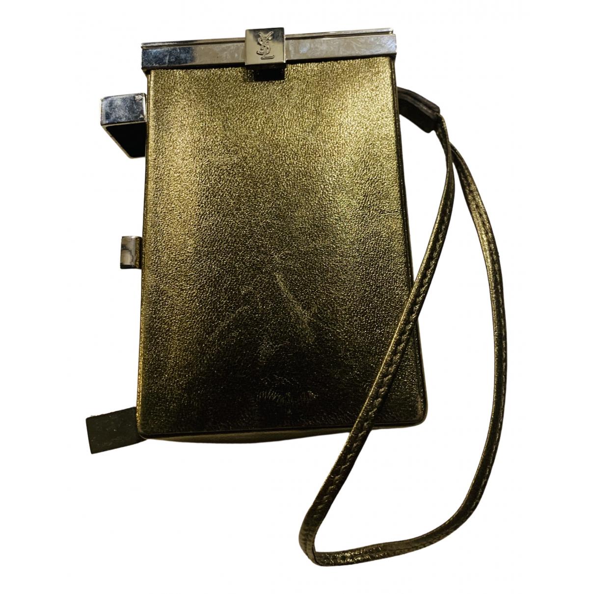 Yves Saint Laurent - Objets & Deco   pour lifestyle en cuir - dore