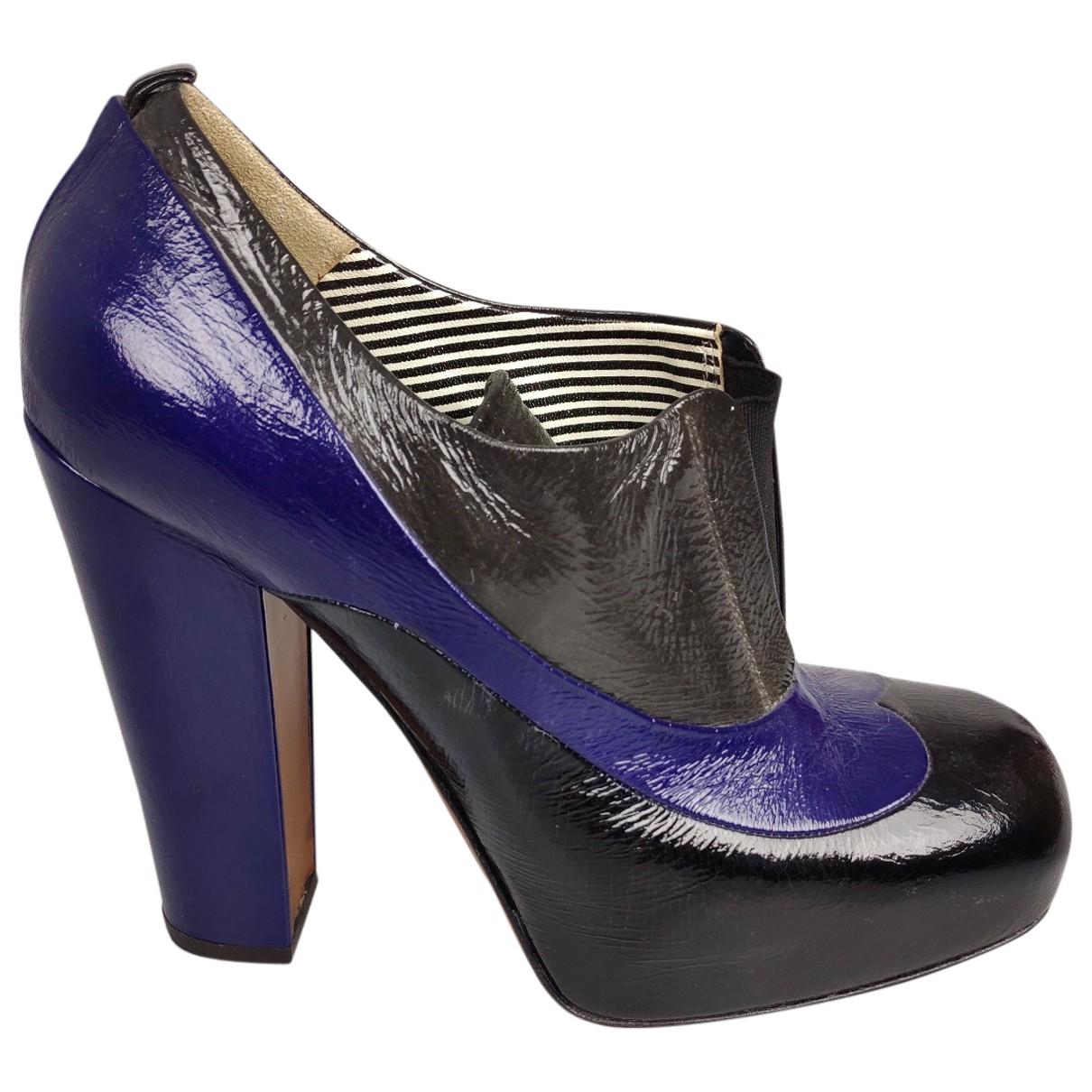 Moschino - Boots   pour femme en cuir verni - noir
