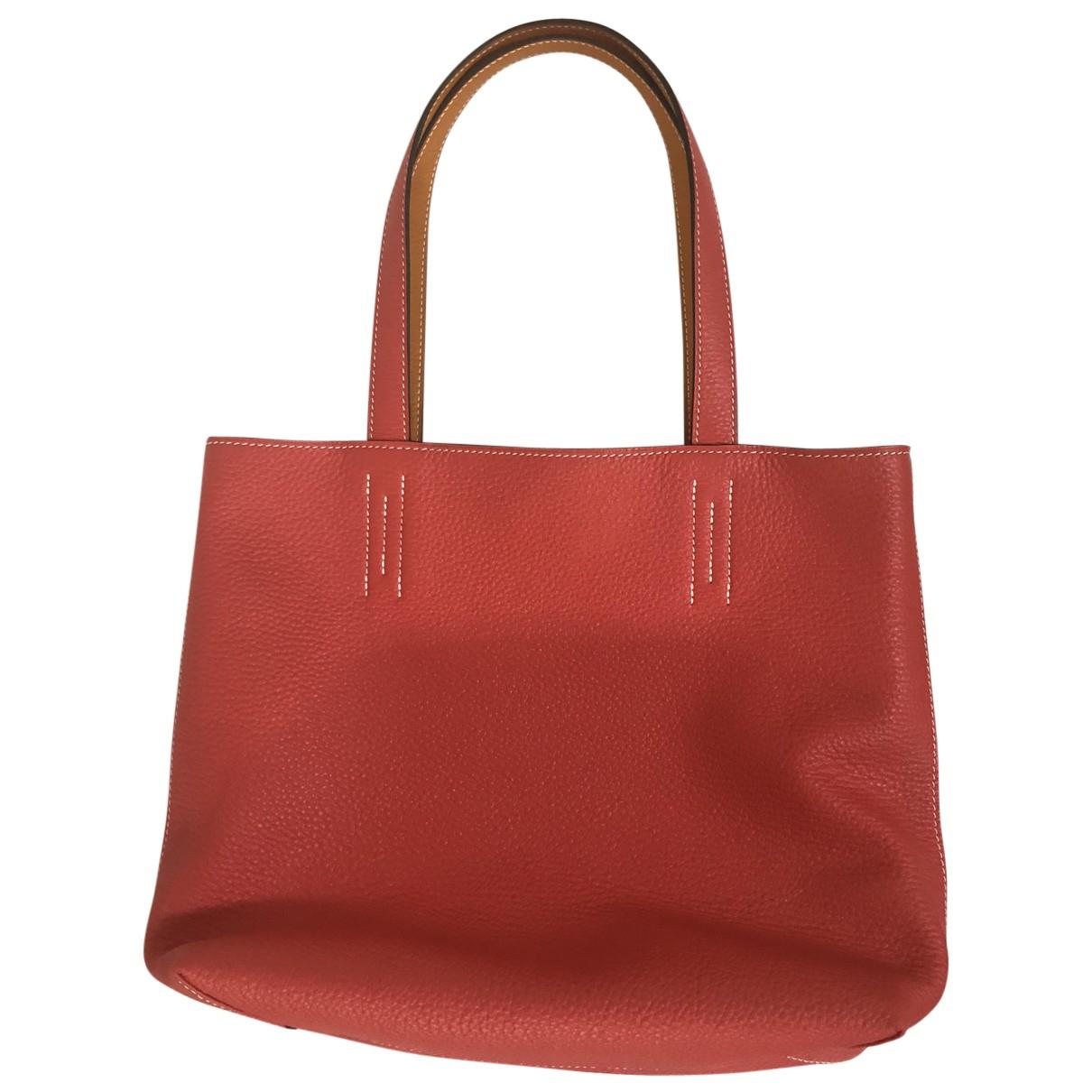 Hermès Double sens Orange Leather handbag for Women N