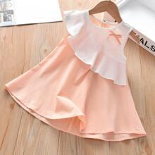 Kleid mit Raffungsaum und Schleife vorn