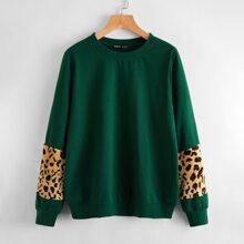 Pullover mit Leopard Muster auf Ärmeln