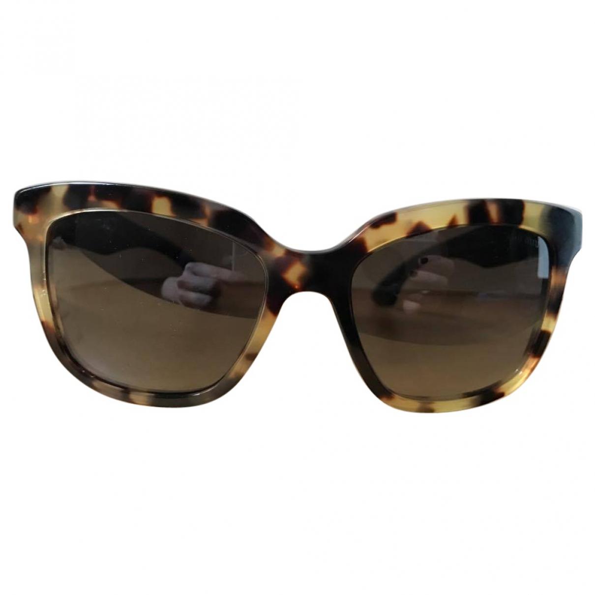 Miu Miu \N Sonnenbrillen in  Braun Kunststoff