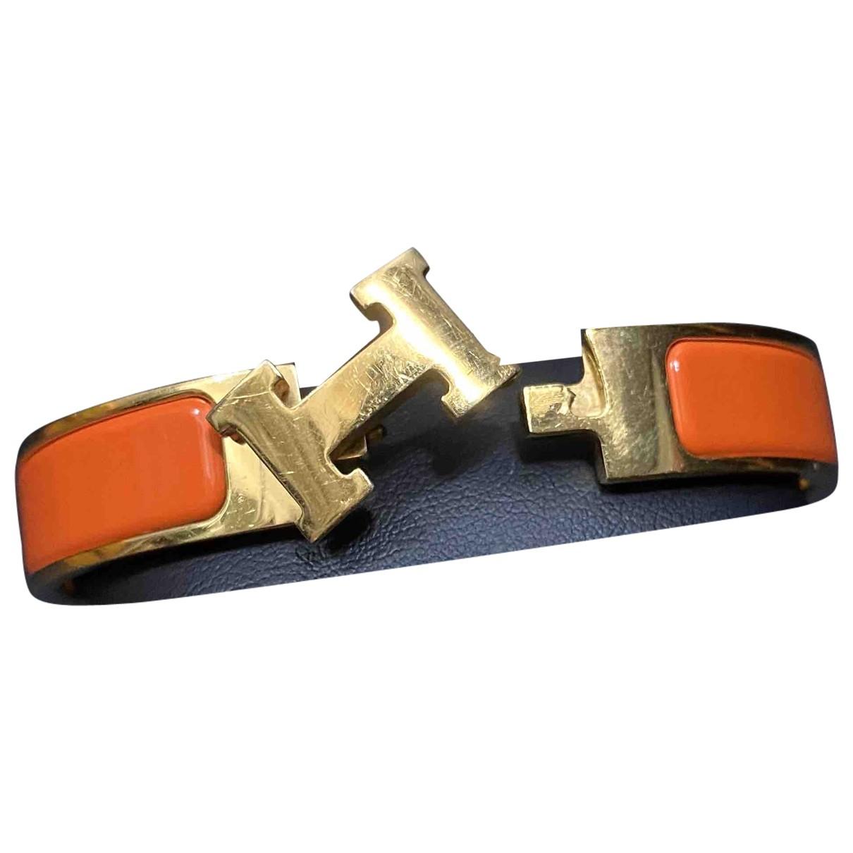 Hermes Clic H Armband in  Orange Metall