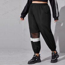 Sportliche Hose mit Kontrast, Netzstoff und Farbblock