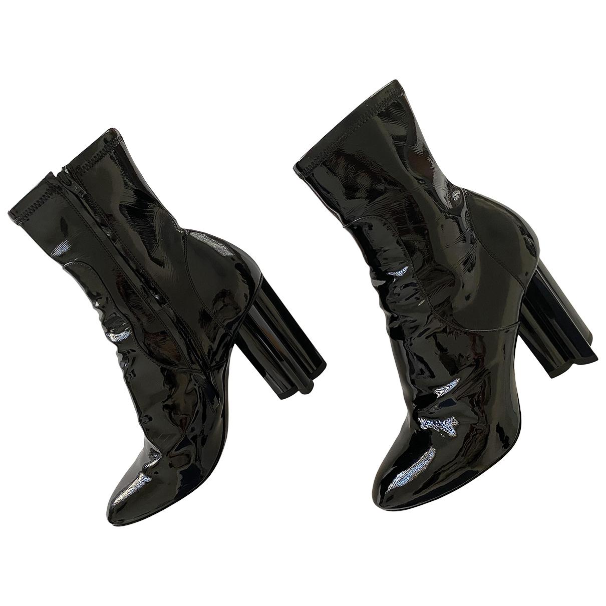 Louis Vuitton - Boots Silhouette pour femme en cuir verni - noir