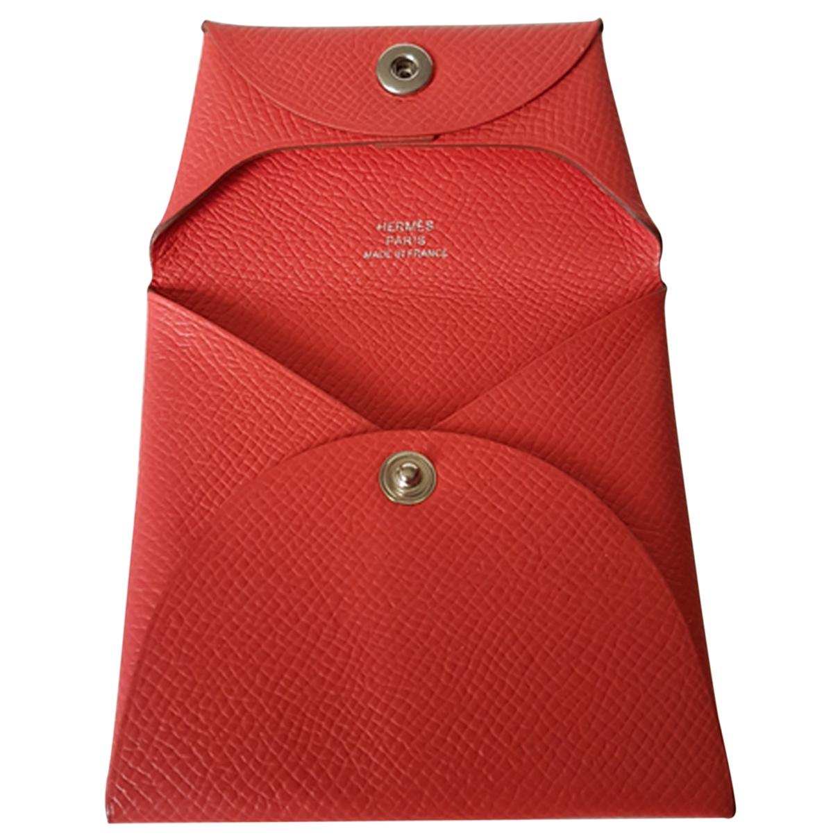 Hermès Bastia Orange Leather Purses, wallet & cases for Women \N