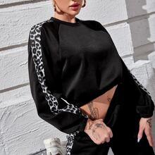 Pullover mit Leopard Muster und Raglanaermeln