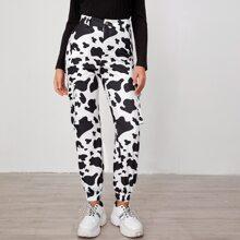 Hose mit Taschen Klappe und Kuh Muster
