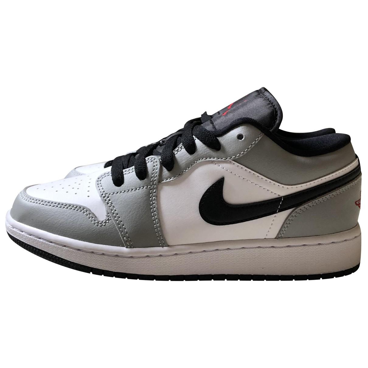 Jordan - Baskets Air Jordan 1  pour femme en cuir - gris