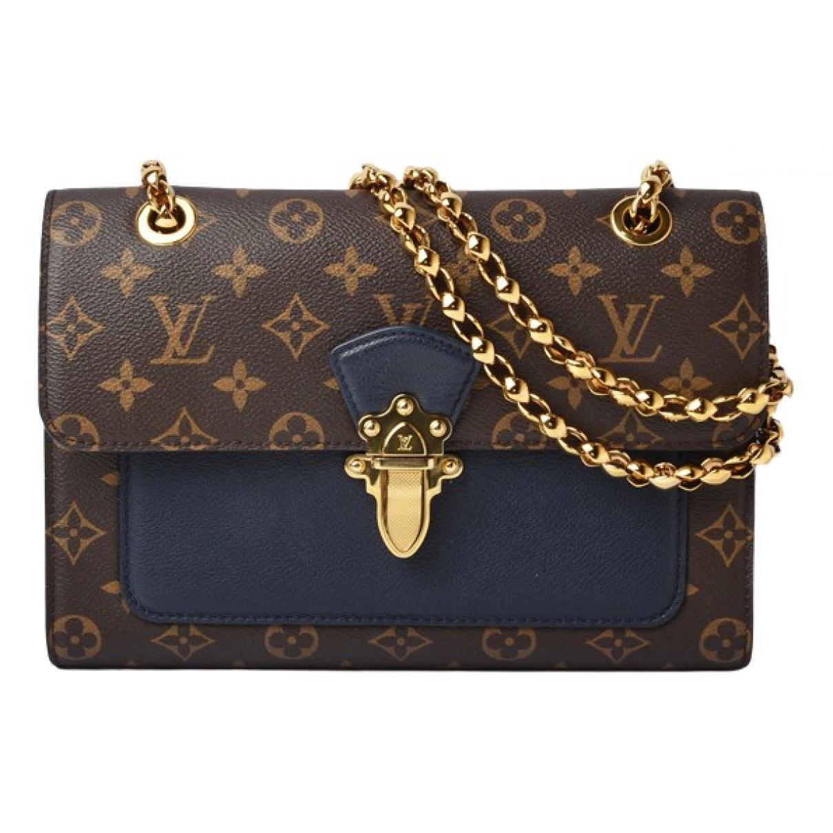 Louis Vuitton Victoire Brown Cloth handbag for Women \N