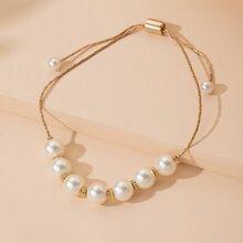 Brazalete con perla artificail